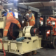 Millwrights moving electrical machinery